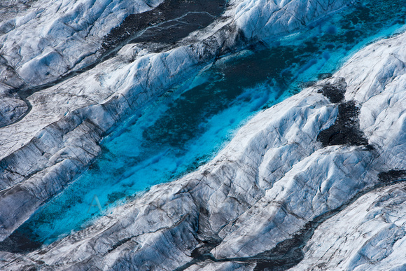 Blue water pools on the glacier